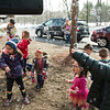 JIM VAIKNORAS/Staff photo Kids play in bubbless at the Annual Salisbury Parks and Recreation's Egg Hunt at Salisbury Elementary School Saturday. Along with a bubble machine, kids enjoyed a clown making balloon animals, cupcakes, face painting, dancing, and a visit from the Easter Bunny.