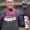 BRYAN EATON/Staff photo. Dr. Eric Cutting is a Newburyport-based chiropractor who happens to also be the defending national champion in alpine skiing for his age group. He won the title up at Okemo recently.