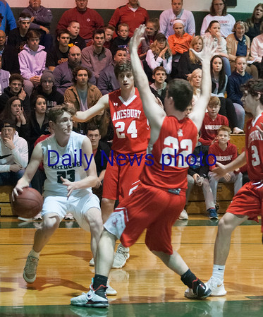 JIM VAIKNORAS/Staff photo  Pentucket's Jake Etter makes a move under the basket against Amesbury during their game at Pentucket Wednesday night.