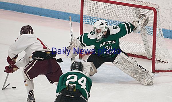 JIM VAIKNORAS/Staff photo Newburyport's Matthew Babcock scores on Austin Prep's Robert Farrell at Chelmsford Forum in Billerica Saturday.