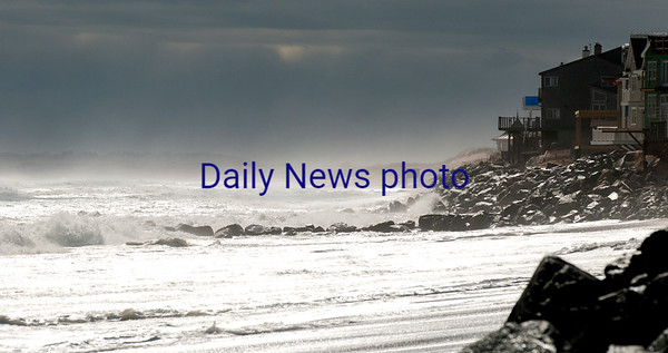 JIM VAIKNORAS/Staff photo High surf on Plum Island looking south from the center parking lot Sunday morning.