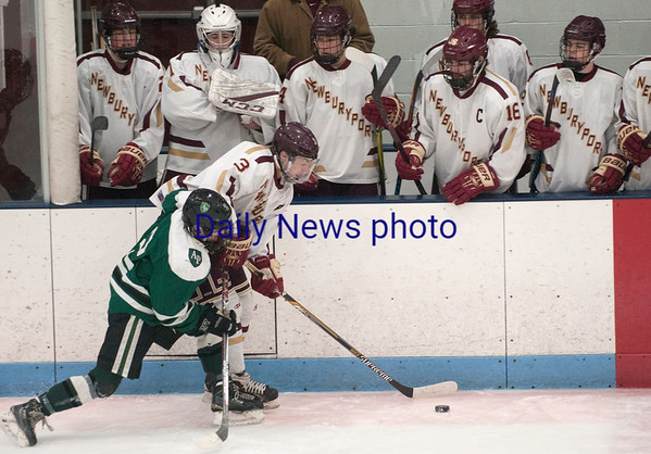 JIM VAIKNORAS/Staff photo Newburyport's Owen Bradbury controls the puck against Austin Prep at Chelmsford Forum in Billerica Saturday.