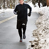 BRYAN EATON/Staff photo. Jim Kelcourse on a five-mile workout runs along Congress Street in Amesbury. The state representative is running in this year's Boston Marathon.