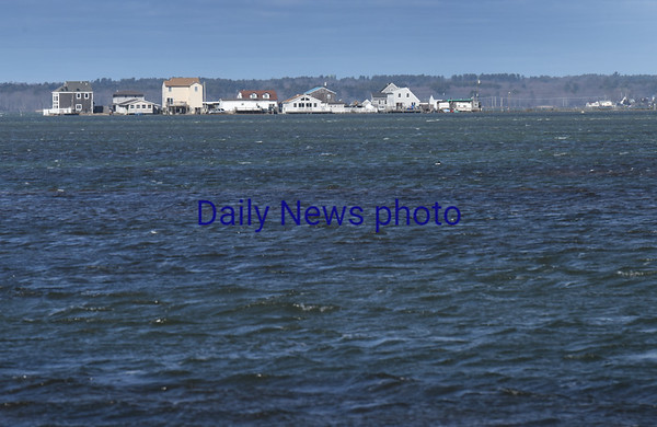 BRYAN EATON/Staff photo. The homes at Cross Beach in Seabrook appear to be on an island on Monday afternoon and likely were during the extreme high tides over the weekend.