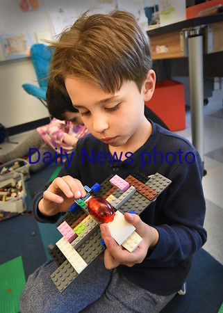 BRYAN EATON/Staff photo. The Breshanan School resumed their afterschool programs last week after a hiatus from the fall session which include various activities for youngsters. Gabriel Simiao, 7, created an airplane in the Lego's class using an owl as a pilot.