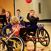 BRYAN EATON/Staff photo. Bresnahan School third-grader Seamus Dolan, 8, reaches for the ball in physical education class where the Similarities Awareness program, from Northeast Passages, was facilitated by the school's physical therapist Jill Grelle. The program teaches students that we all share similarities and to consider that using a wheelchair while playing a sport requires skill and practice and is also challenging, athletic and fun.