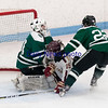 JIM VAIKNORAS/Staff photo Newburyport's Cole Spence ccollides with Austin Prep goalie Robert Farrell at Chelmsford Forum in Billerica Saturday.