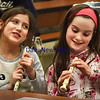 BRYAN EATON/Staff photo. Samantha Evans, left, and Lillian Fulmer, both 8. try to get the hang of positioning their fingers over holes in recorders at Amesbury Elementary School. They were working on their music literacy and learning how to read notes in Alicia Harlov's music class.