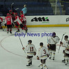 JIM VAIKNORAS/Staff photo Winchester players celebrate their 1st period goal against Newburyport at the Tsongas Center in Lowell Thursday night.