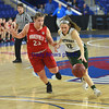 JIM VAIKNORAS/Staff photo Pentucket'sJessica Galvindrives to the basket against Wakefield's Olivia Dziadyk Saturday at the Tsongas Center in Lowell. The win gave the Sachems the North Sectional Championship.