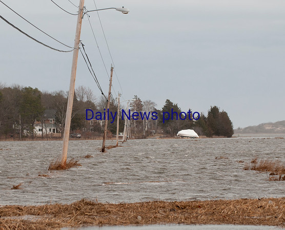 JIM VAIKNORAS/Staff photo Flooding Saturday afternoon at high tide on Pine Island Road in Newbury.