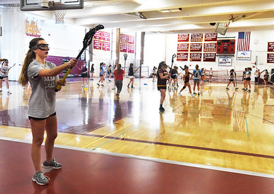 BRYAN EATON/Staff photo. Newburyport sports tryouts were underway Monday, here, girls lacrosse.