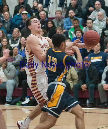 JIM VAIKNORAS/Staff photo Newburyport's Parker McLaren is fouledt against St Mary's at Newburyport Thursday night.
