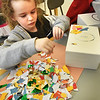 BRYAN EATON/Staff photo. Jack Spring, 6, chooses ripped pieces of colored paper to make a mosaic to decorated a treasure chest he was making Tuesday afternoon. He was in the afterschool program Explorations at Salisbury Elementary School in art class taught by the school's art teacher Jen Bergeron.