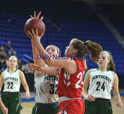 JIM VAIKNORAS/Staff photo Pentucket's Olivia Cross blocks a shot by Wakefield Hannah Dziadyk Saturday at the Tsongas Center in Lowell. The win gave the Sachems the North Sectional Championship.