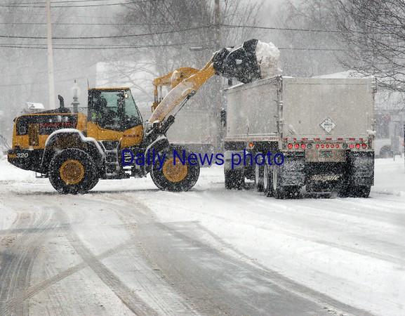 BRYAN EATON/Staff photo. An Amesbury DPW crew puts snow into an awaiting truck to be taken away from the downtown.