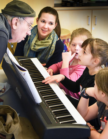 BRYAN EATON/Staff photo. Shelby Shepard looks up to piano instructor Don Weng as he offers instruction on basic notes in piano class in Newburyport's Bresnahan School's Afterschool Enrichment Program on Wednesday. Also in photo, from back, teacher Kaitlyn Zimmerman, Samantha Prescott, Shepard and Katie Kebler. Out of view were Sawyer Alphonse and Aidan Sullivan. Several lessons were missed earlier due to the cancellation of school because of the recent storms.