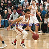 JIM VAIKNORAS/Staff photo Newburyport's George Coryell brings teh ball upt against St Mary's at Newburyport Thursday night.