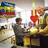 BRYAN EATON/Staff photo. Rose Thorsen has been working in the Amesbury Elementary School front office for four years through the Amesbury Senior Tax Work-off Program. She has since been made to feel at home and the staff, with Principal Walter Helliesen, pictured, presented her with a cake for her birthday, though she wasn't happy to have her picture taken.
