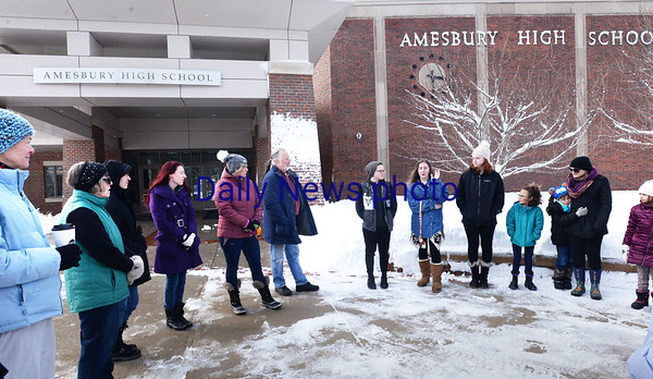 BRYAN EATON/Staff photo. About 20 students and adults showed up at Amesbury High School to protest school shootings and to mark the one month anniversary of the mass shooting in Florida. Students from around Massachusetts also gathered at the Statehouse in Boston.