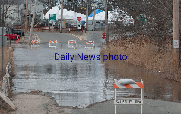 JIM VAIKNORAS/Staff photo 1st Street in Salisbury was one of many roads closed in the area during high tide Saturday.