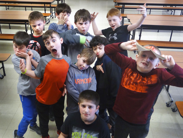 Jim Sullivan/Staff photo. Students in Bruce McBrien's comedy class at Amesbury Elementary School ham it up for the camera.