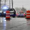 BRYAN EATON/Staff photo. Police block of Plum Island Turnpike which was flooded over during Friday morning's high tide.
