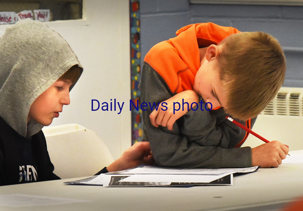 BRYAN EATON/Staff photo. Ayden Gallant, left, and Hunter Thurlow, both 9, work as team as they work on fraction word problems on Wednesday afternoon. They were in the homework/computer room at the Boys and GIrls Club in Salisbury.
