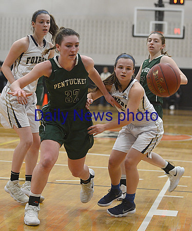 JIM VAIKNORAS/Staff photo Pentucket's Liv Cross fights for a loose ball against Foxboro at Woburn high Wednesday night.