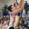 JIM VAIKNORAS/Staff photo Newburyport's Parker McLaren drives to the basket against St Mary's at Newburyport Thursday night.
