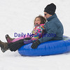 JIM VAIKNORAS/Staff photo Marlow Reczek, 4, screams for joys as she sleds with her dad David at Marches Hill in Newburyport Friday.