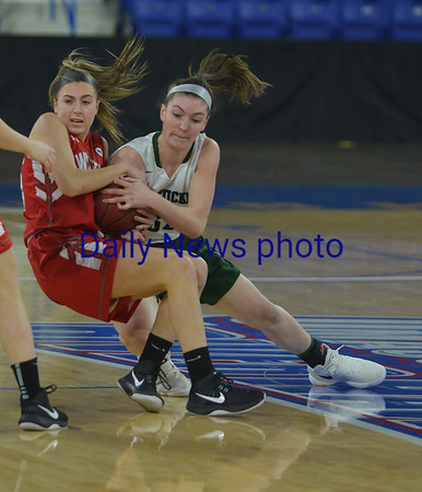 JIM VAIKNORAS/Staff photo Pentucket's Olivia Cross fights for  a loose ball  against Wakefield Saturday at the Tsongas Center in Lowell. The win gave the Sachems the North Sectional Championship.