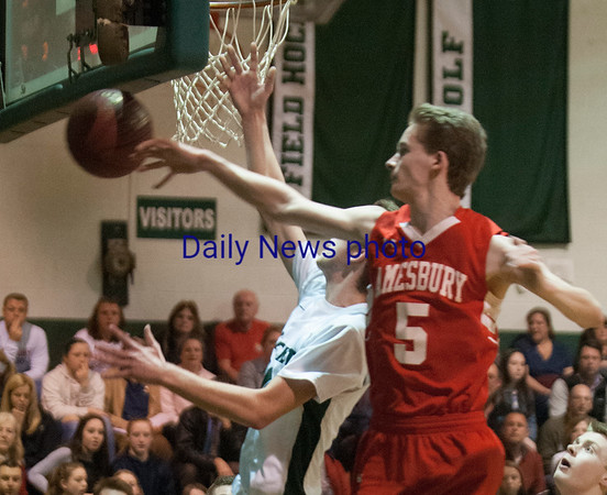 JIM VAIKNORAS/Staff photo Amesbury's John Sydlowski blocks a Pentucket's Justin Snow during their game at Pentucket Wednesday night.