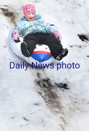 BRYAN EATON/Staff photo. Jillian Ballard, 4, of Salisbury has a blast sledding down a run at March's Hill in Newburyport on Wednesday afternoon. The snow should stick around for awhile as temperatures do not climb that high despite stronger sunlight.