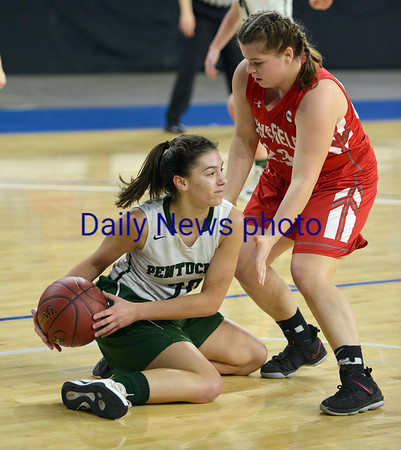 JIM VAIKNORAS/Staff photo Pentucket's Olivia Hunt grabs a loose ball against Wakefield's Olivia Dziadyk Saturday at the Tsongas Center in Lowell. The win gave the Sachems the North Sectional Championship.