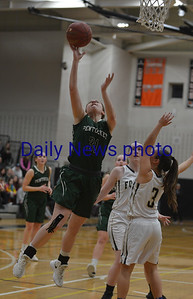 JIM VAIKNORAS/Staff photo Pentucket's Emily Riley scores against Foxboro at Woburn high Wednesday night.