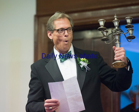 "JIM VAIKNORAS/Staff photo Chuck Withee hold a candle stick as he sings ""Be Our Guest"" during Irish Idol at the Link House, Inc. St. Patrick's Day luncheon and fundraiser Friday morning at the Masons in Newburyport."