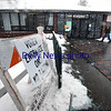 BRYAN EATON/Staff photo. Despite the wind and heavy snow, voters head into the Seabrook Community Center as state law states that no election can be postponed.