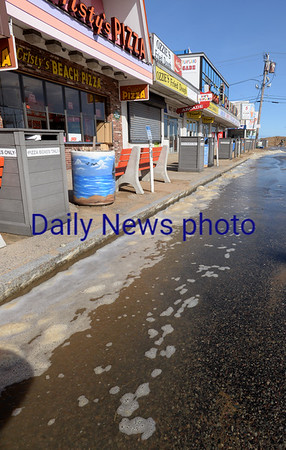 BRYAN EATON/Staff photo. Even though the Salisbury DPW piled mounds of sand at the end of Broadway at Salisbury Beach, some water still made it down during Monday afternoon's high tide.