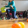 JIM VAIKNORAS/Staff photo Zoe Johnson , 7, rushes to grab some eggs at the Annual Salisbury Parks and Recreation's Egg Hunt at Salisbury Elementary School Saturday. Along with the hunt, kids enjoyed a clown making balloon animals, cupcakes, face painting, dancing, a bubble machine and a visit from the Easter Bunny.