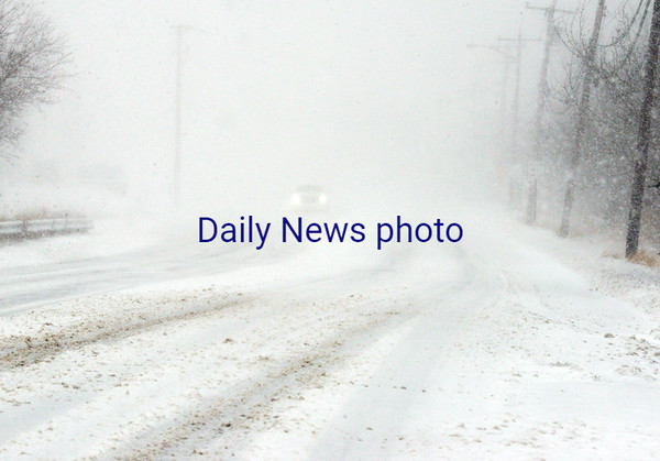 BRYAN EATON/Staff photo. Motorists faced blizzard-like conditions in several areas, and here on Beach Road in Salisbury.