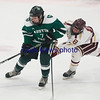 JIM VAIKNORAS/Staff photo Newburyport's Robbie Johnson knocks the puck away from Austin Prep's Sulivan Marino at Chelmsford Forum in Billerica Saturday.