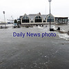 BRYAN EATON/Staff photo. The Newburyport boardwalk at Somerby's Landing covered with water.