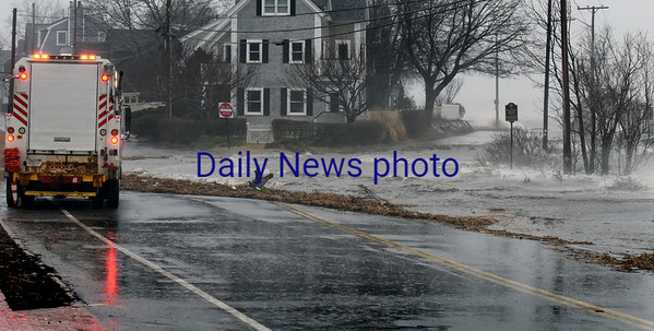 BRYAN EATON/Staff photo. Water Street at Union is closed at water from the Merrimack River laps over.