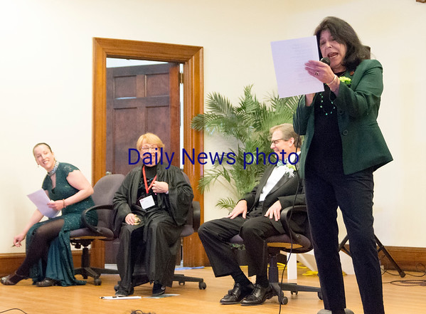 JIM VAIKNORAS/Staff photo Newburyport Mayor Donna Holaday performs for judges, Kathleen O'Connor Ives, Cynthia Costello and Chuck Withee during Irish Idol at the Link House, Inc. St. Patrick's Day  luncheon and fundraiser Friday morning at the Masons in Newburyport.