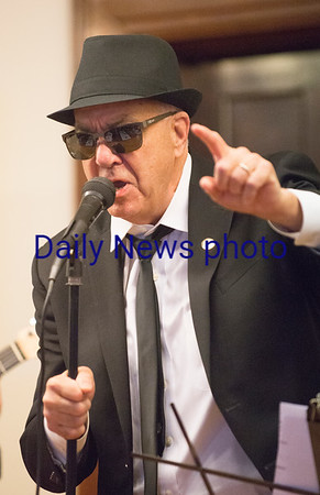 JIM VAIKNORAS/Staff photo Amesbury Mayor Ken Gray sings the blues during Irish Idol at the Link House, Inc. St. Patrick's Day  luncheon and fundraiser Friday morning at the Masons in Newburyport.