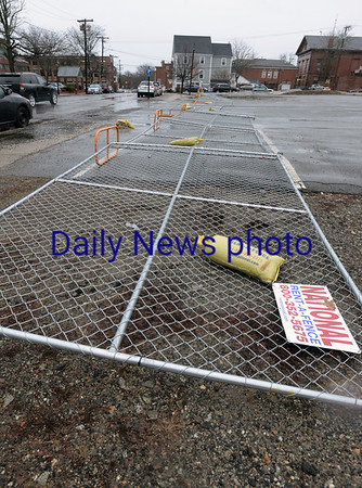 BRYAN EATON/Staff photo. Fencing at the site of the parking lot on Merrimac Street in Newburyport blew down during the storm.