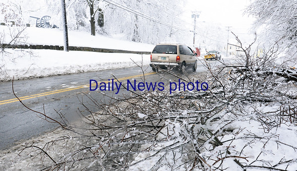 BRYAN EATON/Staff photo. Limbs litter a long stretch of Elm Street in Amesbury near Mt. Prospect Cemetery.
