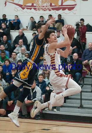 JIM VAIKNORAS/Staff photo Newburyport's Ryan Archie is fouled as he glides to the basket against St Mary's at Newburyport Thursday night.