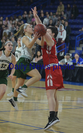 JIM VAIKNORAS/Staff photo Pentucket's Madeline Doyle drives to the basket against Wakefield Saturday at the Tsongas Center in Lowell. The win gave the Sachems the North Sectional Championship.